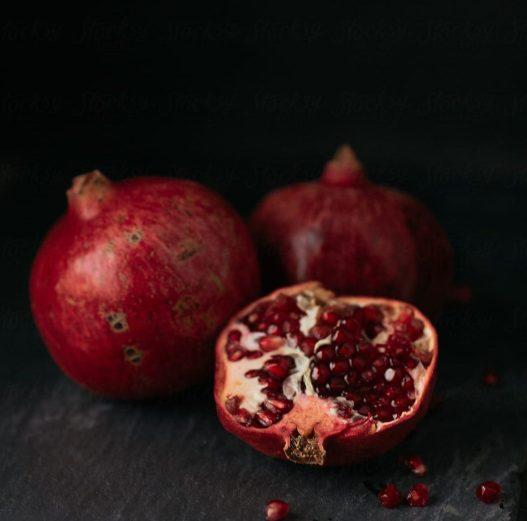 cropped-fresh-pomegranate-on-slate-in-a-dark-moody-kitchen-by-levi-tijerina-for-stocksy-united-1.jpg